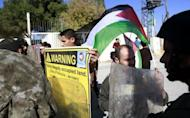 Palestinians hold a weekly protest against Israel's separation barrier in the West Bank village of Maasarah. On Thursday, the United Nations General Assembly overwhelmingly backed a resolution recognising Palestine within the 1967 borders as a non-member observer state