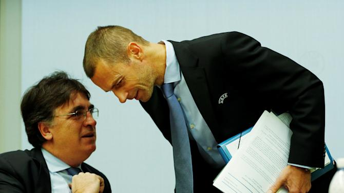 UEFA President Ceferin talks with UEFA general secretary Theodoridis before an Executive Board meeting in Nyon