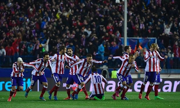 Atletico Madrid's players celebrate after wining the UEFA Champions League football match Club Atletico de Madrid vs Bayer Leverkusen in Madrid on March 17, 2015
