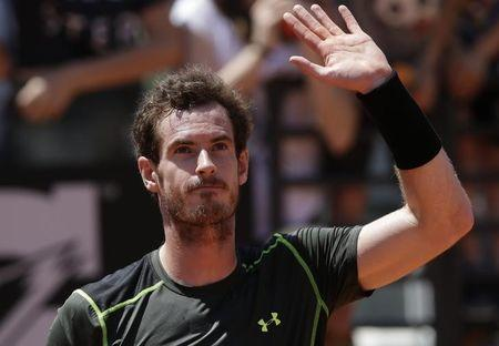 Murray of Britain celebrates after beating Chardy of France during their second round match at Rome Open tennis tournament