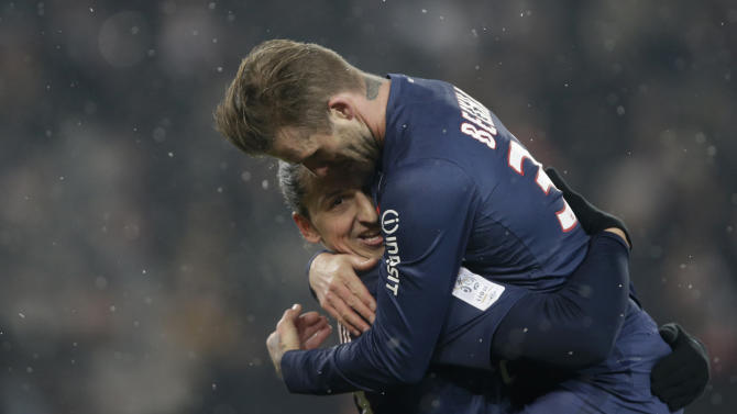 Paris Saint-Germain's Beckham congratulates Ibrahimovic after his goal against Olympic Marseille in their French Ligue 1 soccer match at Parc des Princes stadium in Paris