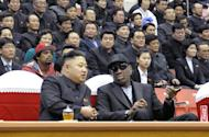 This photo released by North Korea's official Korean Central News Agency (KCNA) on March 1, 2013 shows North Korean leader Kim Jong-Un (front L) and former NBA star Dennis Rodman speaking at a basketball game in Pyongyang. Rodman, who forged an unlikely friendship with Kim on a recent trip, appealed Tuesday for the freedom of an American sentenced to 15 years