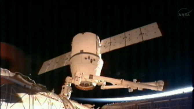 This image provided by NASA-TV shows the SpaceX Dragon commercial cargo craft after it was detached from the International Space Station early Tuesday March 26, 2013 by the International Space Station's Canadarm2 robotic arm. The two spacecraft were traveling Canada at the time. The rising sun and the curvature of the earth can be seen behind the spacecraft. The Dragon is expected to splash down in the eastern Pacific ocean approximately 246 miles off the coast of Baja Calif., later this morning. (AP Photo/NASA)