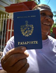 Cruz Duran shows her Cuban passport, in Havana, on October 16, 2012. A law allowing Cubans to travel abroad without special exit visas has taken effect on the communist-ruled island for the first time in half a century