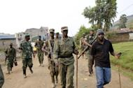 Colonel Sultani Makenga (C), head of the rebel M23 group, tours Bunagana, a town near the border in Uganda, on July 8. United Nations helicopters on Tuesday fired on rebel positions in eastern Democratic Republic of Congo after new clashes broke out there between rebel fighters and loyalist troops, officials said