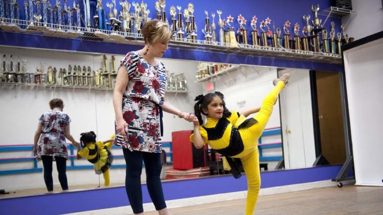 "Cathy and her daughter Vivi-Anne star in ""Dance Moms."""
