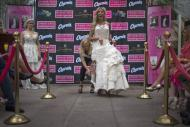 Designer and model Susan Brennan of Orchard Lake, Michigan is helped by an assistant during the 10th annual toilet paper wedding dress contest in Midtown, New York June 12, 2014. REUTERS/Adrees Latif