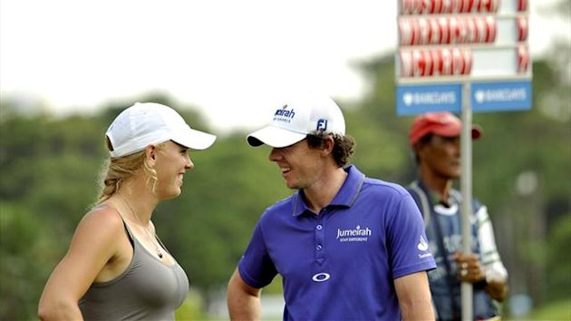 Rory McIlroy and his girlfriend Caroline Wozniacki in Singapore (AFP)
