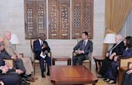 """Joint UN-Arab Syria envoy Kofi Annan (C-L) meets Syrian President Bashar al-Assad (C-R) in Damascus on May 29, in an image released by the Syrian Arab News Agency. Annan told Assad of the world's """"grave concern"""" about violence in Syria, including the Houla massacre, in a meeting on Tuesday, the peace envoy's office said"""