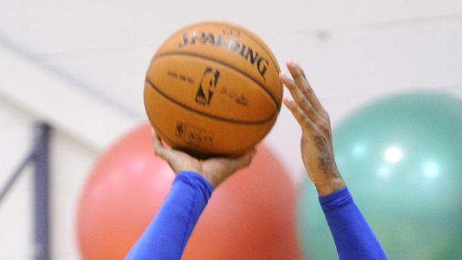 New York Knicks' Carmelo Anthony shoots during NBA basketball training camp Tuesday, Oct. 1, 2013, in Greenburgh, N.Y