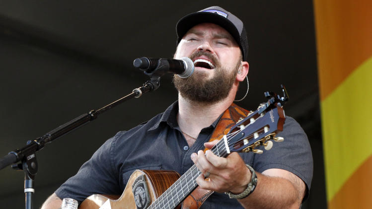 FILE - This May 4, 2012 file photo shows Zac Brown performing with the Zac Brown Band at the New Orleans Jazz and Heritage Festival in New Orleans. The Zac Brown Band will perform at the Daytona 500 season opening race on Feb. 24. (AP Photo/Gerald Herbert, file)
