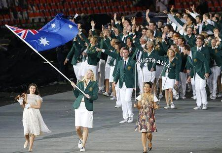 Australia's flag bearer Lauren Jackson holds the national flag as she leads the contingent in the athletes parade during the opening ceremony of the London 2012 Olympic Games at the Olympic Stadiu