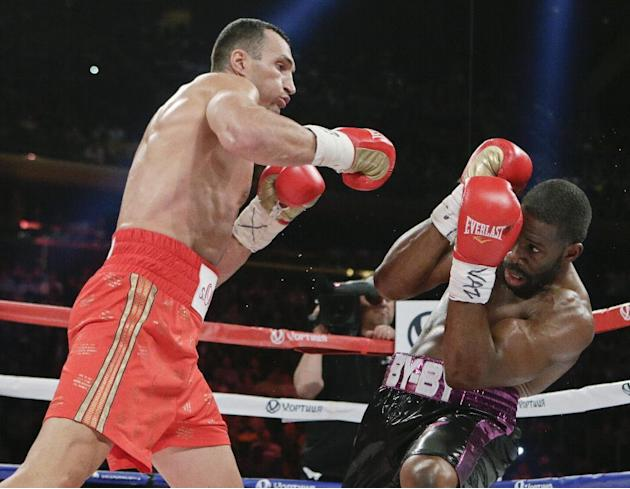 Wladimir Klitschko, left, of Ukraine, fights Bryant Jennings during the second round a boxing match Saturday, April 25, 2015, at Madison Square Garden in New York. (AP Photo/Frank Franklin II)