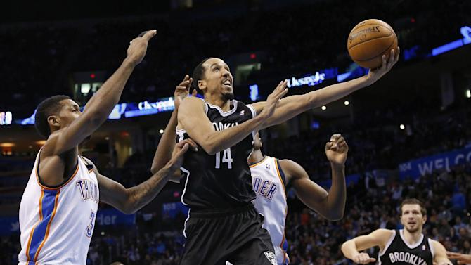 Brooklyn Nets guard Shaun Livingston (14) shoots in front of Oklahoma City Thunder forward Perry Jones (3) and forward Serge Ibaka in the second quarter of an NBA basketball game in Oklahoma City, Thursday, Jan. 2, 2014
