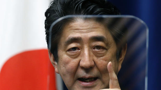 Japan's Prime Minister Shinzo Abe speaks during a press conference at the prime minister's official residence in Tokyo, Thursday, March 20, 2014. A big question looms as the leaders of Japan and South Korea head to Europe next week: Will they finally meet? Friction over Japan's brutal colonization of Korea in the first half of the 20th century has prevented a summit between Abe and South Korean President Park Geun-hye since they both took office more than a year ago. (AP Photo/Shizuo Kambayashi)