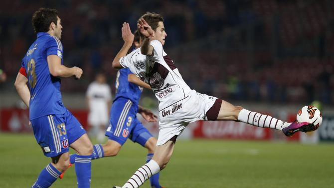 Jose Manuel Rojas of Chile's Universidad de Chile fights for the ball with Lucas Melano of Argentina's Lanus during their Copa Sudamericana soccer match in Santiago