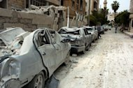 A picture released by the official Syrian Arab News Agency (SANA) shows vehicles that were damaged following blasts in the city of Idlib, northwest Syria. Twin blasts targeting security buildings killed more than 20 people in the northwest Syrian city of Idlib, a monitoring group said, as the chief UN monitor presses both sides to end more than 13 months of violence