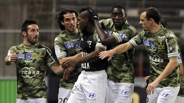 Bastia forward Djibril Cisse celebrates with team-mates after scoring against Toulouse (AFP)