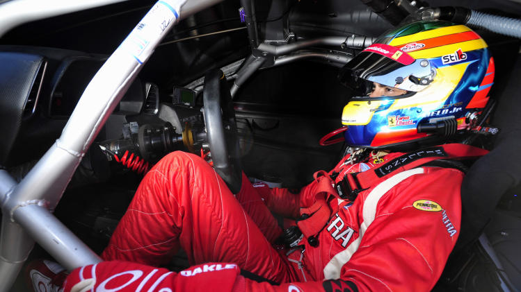 Risi Competizione Ferrari driver Jaime Melo waits in his car before qualifying for the American Le Mans Series' Petit Le Mans auto race at Road Atlanta, Friday, Sept. 30, 2011, in Braselton, Ga. (AP Photo/Rainier Ehrhardt)