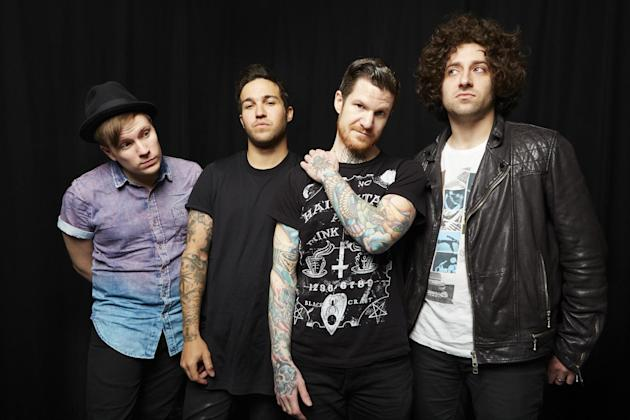 "This April 12, 2013 photo shows members of the band Fall Out Boy, from left, Patrick Stump, Pete Wentz, Andy Hurley and Joe Trohman in New York. Fall Out Boy's new album, ""Save Rock and Roll,"" release"