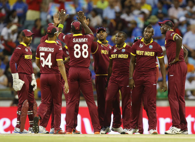 West Indies player's after the dismissal of Indian batsman Shikhar Dhawan during their Cricket World Cup Pool B match in Perth, Australia, Friday, March 6, 2015. (AP Photo/Theron Kirkman)