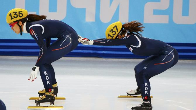 South Korea's Kong Sang-jeong pushes teammate Cho Ha-Ri during the women's 3,000 metres short track speed skating semi-finals relay race at the Iceberg Skating Palace during the 2014 Sochi Winter Olympics