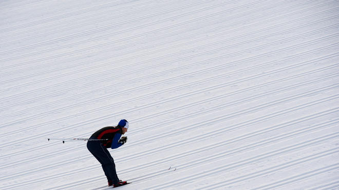 A Skier Warms AFP/Getty Images