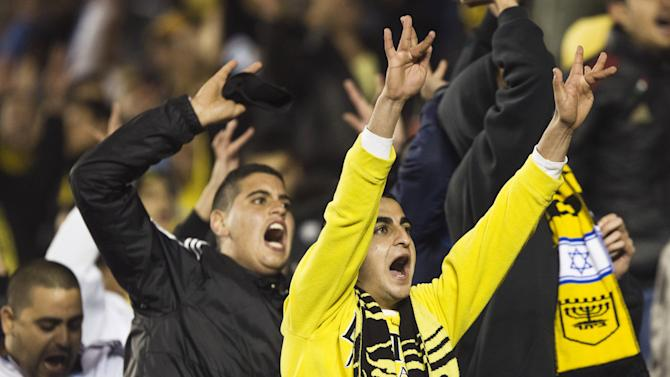 File photo shows supporters of Beitar Jerusalem gesturing during a soccer match in Jerusalem