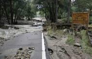 Main Street is cut in half with James Creek at the entrance to Jamestown, Colorado, after a flash flood destroyed much of the town, September 14, 2013. REUTERS/Rick Wilking