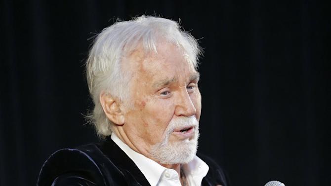 Kenny Rogers speaks on Wednesday, April 10, 2013, in Nashville, Tenn., during the announcement that he will be inducted into the Country Music Hall of Fame. Rogers will be inducted with Bobby Bare and Jack Clement. (AP Photo/Mark Humphrey)