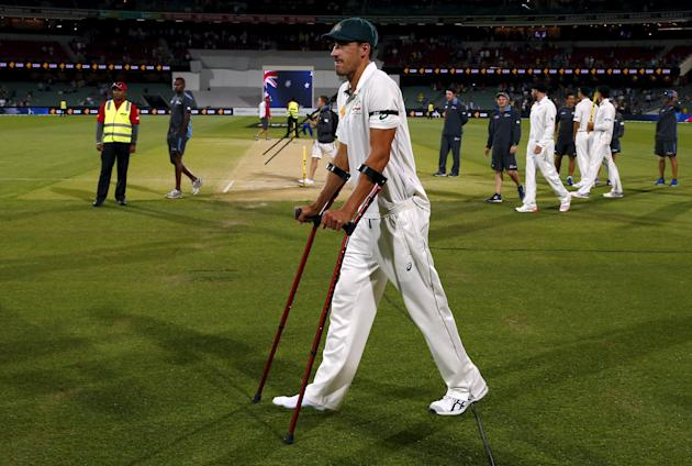 Australia's Starc uses crutches as he walks to the presentation ceremony after the third day of the third cricket test match against New Zealand in South Australia