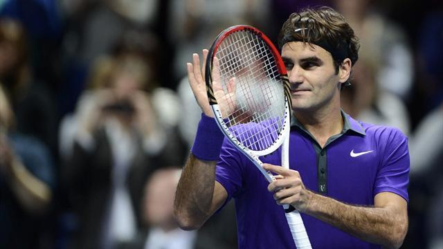 ATP World Tour Finals - Federer cruises to record win over Tipsarevic in London
