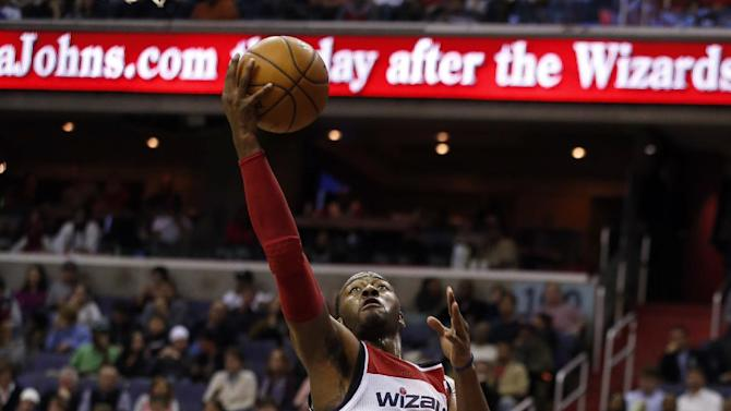 Washington Wizards guard John Wall (2) shoots in front of Los Angeles Clippers guard Willie Green (34) in the second half of an NBA basketball game, Saturday, Dec. 14, 2013, in Washington. The Clippers won 113-97