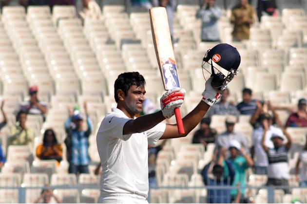 Indian batsman Ravichandran Ashwin celebrates his century during the 3rd day of the 1st test match between India and West Indies at Eden Gardens, Kolkata on Nov. 8, 2013. (Photo: IANS)