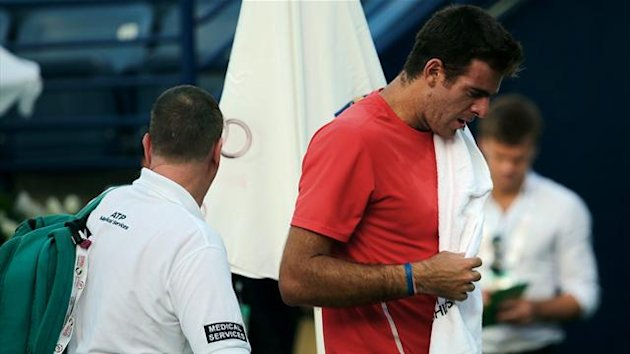 Juan Del Potro walks off the court after retiring at the end of his first set against Somdev Devverman due to an injured wrist at the Dubai Tennis Championships (AFP)