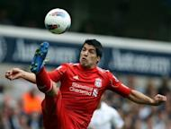 Liverpool's Uruguayan striker Luis Suarez stretches to control the ball during the Premier League match against at White Hart Lane in north London, 2011. Liverpool will play Tottenham in Baltimore in July it was confirmed as the Premier League club revealed more details of their pre-season tour to North America