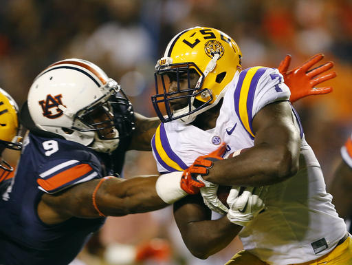 Auburn defensive end Byron Cowart (9) underwent an emergency appendectomy on Wednesday and will miss the rest of the season. (AP)