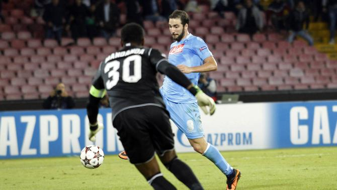 Napoli's Higuain scores against Olympique Marseille during their Champions League soccer match at San Paolo stadium in Naples