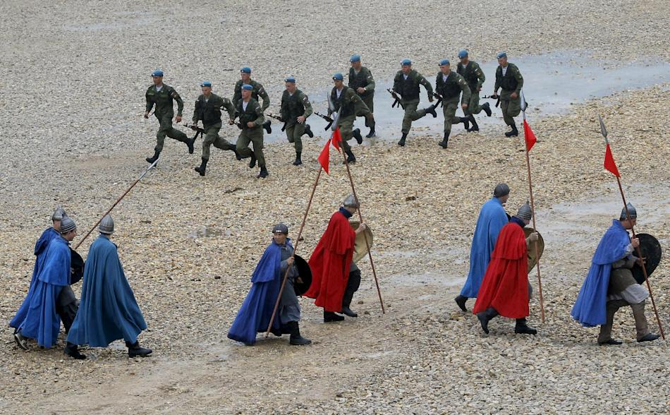 Participants dressed as Old Russian knights and Russian paratroopers take part in an opening ceremony of the International Army Games-2015 in Alabino