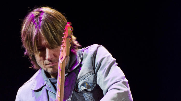 Keith Urban performs at Eric Clapton's Crossroads Guitar Festival 2013 at Madison Square Garden on Saturday, April 13, 2013, in New York. (Photo by Charles Sykes/Invision/AP)