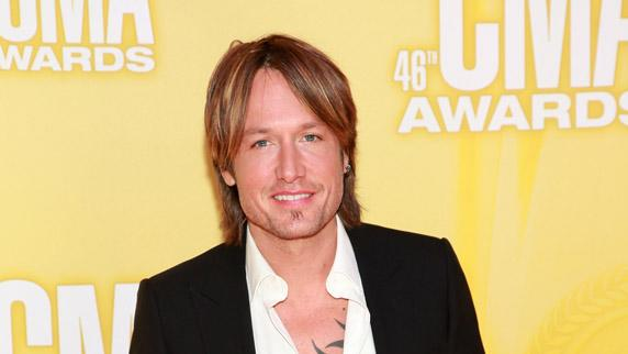 "You'd think Keith Urban would have shaved for the big night! But the ""Sweet Thing"" singer, who stepped out sans his movie star wife Nicole Kidman, sported lots of scruff, his usual long locks, and a fitted black suit that showed off his chest tattoo. The Aussie was up for Male Vocalist of the Year. (11/1/2012)"