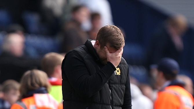 MK Dons boss Karl Robinson has a challenge on his hands