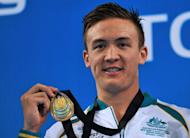 Robert Hurley of Australia smiles on the podium after winning the men's 50m backstroke final during the FINA World Short Course Swimming Championships in Istanbul