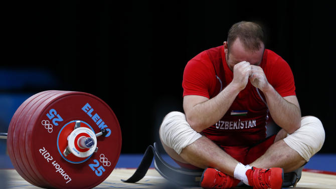 Uzbekistan's Ruslan Nurudinov reacts after failing a lift in the men's 105kg Group A weightlifting clean and jerk competition during the London 2012 Olympic Games
