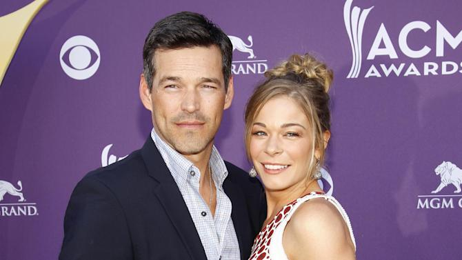 """FILE - This April 1, 2012 file photo shows country singer LeAnn Rimes, right, and her husband Eddie Cibrian at the 47th Annual Academy of Country Music Awards in Las Vegas. The couple will have a six-episode series on VH1, scheduled to debut either later this year or in early 2014 and tentatively called """"LeAnn & Eddie."""" (AP Photo/Isaac Brekken, File)"""