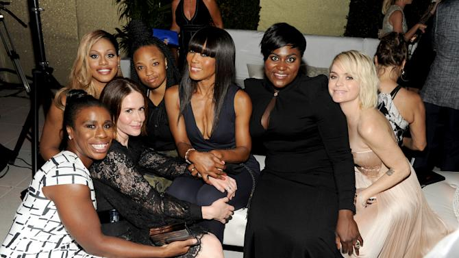 """IMAGE DISTRIBUTED FOR THE TELEVISION ACADEMY - The cast of """"Orange Is The New Black"""" with nominees Sarah Paulson, second from left, and Angela Bassett, fifth from left, attend the Television Academy's 66th Emmy Awards Performance Nominee Reception at the Pacific Design Center on Saturday, Aug. 23, 2014, in West Hollywood, Calif. (Photo by Frank Micelotta/Invision for the Television Academy/AP Images)"""
