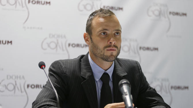 Paralympic and Olympic runner Pistorius of South Africa speaks during a news conference after the official opening ceremony of the Doha GOALS forum in Doha