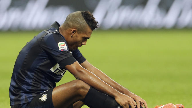 Inter Milan Brazilian defender Juan Jesus sits on the field at the end of the Serie A soccer match between Inter Milan and Udinese at the San Siro stadium in Milan, Italy, Thursday, March 27, 2014. The match ended in a scoreless draw