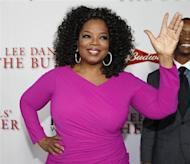 """Actress Oprah Winfrey, a cast member of the film """"Lee Daniels' The Butler"""", poses at the film's premiere in Los Angeles August 12, 2013. REUTERS/Fred Prouser"""
