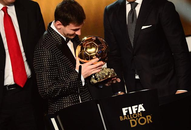 Barcelona's Argentinian forward Lionel Messi receives the FIFA Ballon d'Or award during the FIFA Ballon d'Or awards ceremony at the Kongresshaus in Zurich on January 7, 2013